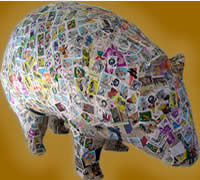 Model of a wombat, the children have covered with stamps